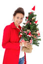 Woman with christmas tree pretty young isolated on white Royalty Free Stock Photography