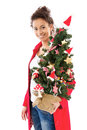 Woman with christmas tree pretty young isolated on white Stock Image