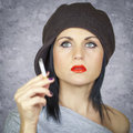Woman with cigarette on grey background Stock Image