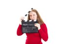 Woman with clapperboard in her hands smiling Stock Photo