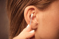 Woman cleaning ear with cotton swabs closeup Royalty Free Stock Photo