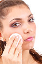 Woman is cleaning face Royalty Free Stock Image