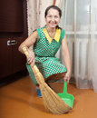 Woman cleaning floor with dustpan Stock Images