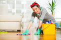 Woman cleaning the floor while kneeling Royalty Free Stock Photo