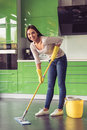 Woman cleaning her kitchen Royalty Free Stock Photo