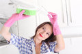 Woman cleaning kitchen Royalty Free Stock Image