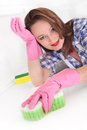 Woman cleaning kitchen Royalty Free Stock Photography