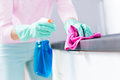 Woman Cleaning Kitchen Counter Royalty Free Stock Photo