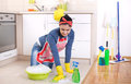 Woman cleaning kitchen floor Royalty Free Stock Photo