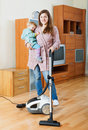 Woman  cleaning living room with vacuum cleaner Royalty Free Stock Photo