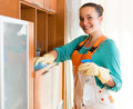 Woman cleaning office room