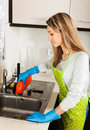 Woman cleaning pipe with detergent Royalty Free Stock Photo