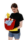 Woman with cleaning staff a young in shorts and yellow rubber cloves holding up an red bucket ready for for white background Stock Images