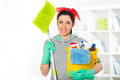 Woman with cleaning supplies in the living room smiling Royalty Free Stock Images