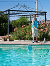 image photo : Woman cleaning swimming pool