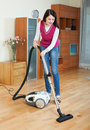 Woman cleaning with vacuum cleaner full length shot of at home Stock Photos