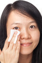 Woman cleansing face asian young Royalty Free Stock Image