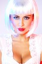 Woman with cleavage wearing white wig close up seductive portrait of Royalty Free Stock Photo