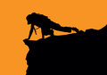 Woman climb silhouette on a orange background Royalty Free Stock Photos