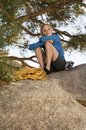 Woman climber sitting on boulder Stock Photos