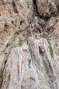 Woman climbing incredible wall railay beach in thailand Stock Photo