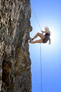 Woman climbing rock full length of young Royalty Free Stock Photography