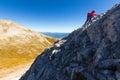 Woman climbing steep mountain slope mountaineer rock vihren pirin mountains bulgaria Royalty Free Stock Image