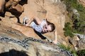 Woman Climbing Up Lions Head Stock Images