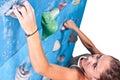 Woman on climbing wall Stock Photography