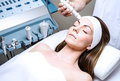 Woman in the clinic a beauty by becoming a facial Stock Photography