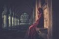 Woman in cloak praying Royalty Free Stock Photo