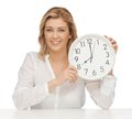 Woman with clock picture of in casual clothes Stock Photography