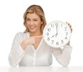 Woman with clock picture of in casual clothes Stock Photos