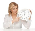 Woman with clock picture of in casual clothes Stock Images