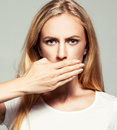 Woman with closed mouth female covers her her hands silence fear violence Royalty Free Stock Photography