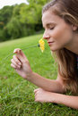 Woman closing her eyes while smelling a flower Royalty Free Stock Image