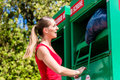 Woman at clothes recycling skip happy Stock Image