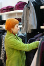 Woman in Clothes shop Royalty Free Stock Photos