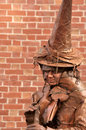 Woman in clothes of witch on the halloween fair salem usa october salem ma usa brown costume looks at crowd Stock Photos