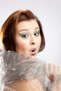 Woman with clown make up astonished glance of a face Royalty Free Stock Photos
