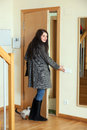 Woman in coat  leaving  home Royalty Free Stock Photo