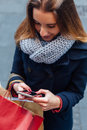 Woman in coat texting on mobile phone Royalty Free Stock Photo