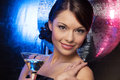 Woman with cocktail and disco ball Stock Image