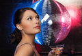 Woman with cocktail and disco ball Royalty Free Stock Photo