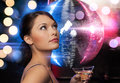 Woman with cocktail and disco ball luxury vip nightlife party concept beautiful in evening dress Stock Image