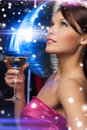 Woman with cocktail luxury vip nightlife party christmas x mas new year s eve concept beautiful in evening dress and disco ball Royalty Free Stock Images