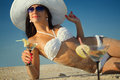 Woman with cocktail relaxing on beach Royalty Free Stock Image