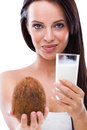 Woman with coconut and coconut milk beautiful young Royalty Free Stock Photos