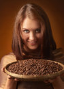 Woman with coffee beans Royalty Free Stock Photo