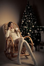 Woman with coffee in chair. Christmas decorati Royalty Free Stock Image